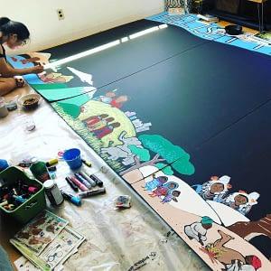 preparing knowledge wall, graphic recording preparation, painting black foam board, acrylic on foam board, visual facilitation, interactive graphic recording vancouver bc